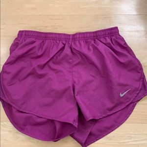 Purple Nike running shorts
